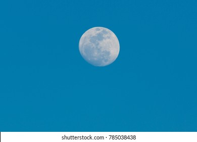 full moon on blue sky background in the daytime