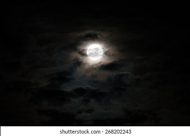 Full moon on a cloudy night.