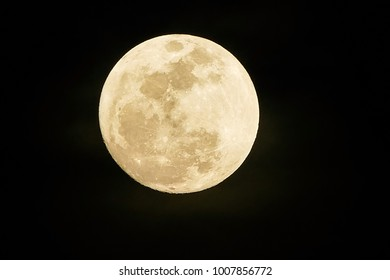 Full moon on dark black sky at night