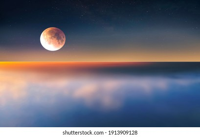 full moon on sunset at sea  cloudy fluffy  blue starry sky  reflection on sea water