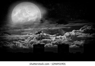 Full moon over a gloomy, deserted city