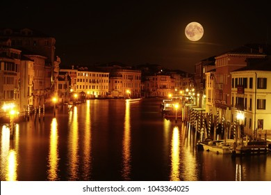 Full Moon Over The Grand Canal. Long exposure photograph of Grand Canal by night with stunning full moon view. Venice, Italy