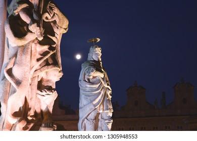 full moon over Marian column, Charles square, city Kolín, Czech Republic,