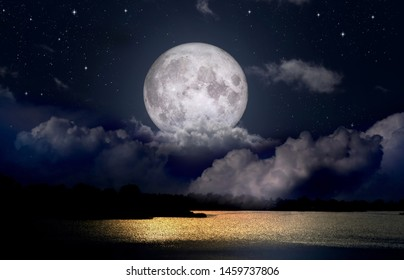 Full moon over the night lake