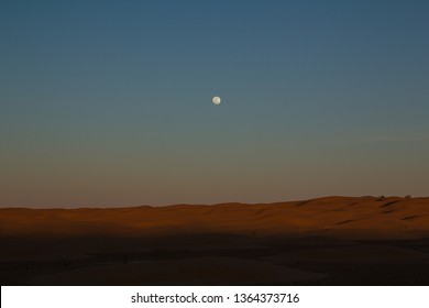 Full moon over the sand dunes of the northern Sahara in Tunisia below Dousz