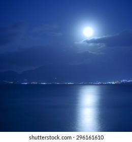 Full moon over sea and moon-glade, Crete Island, Greece