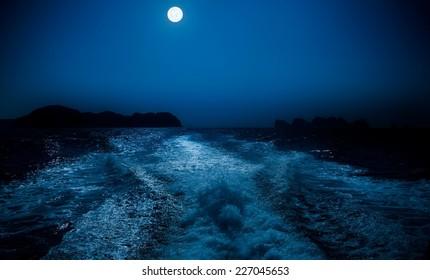 Full moon over sea surface.