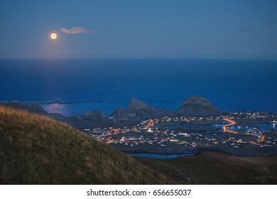 full moon over the sea, view from the hill