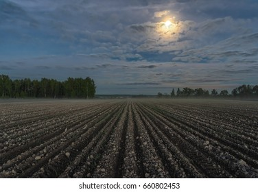 Full moon over spring field. Central Russia