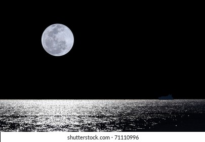 Full moon over water with abstract shining water