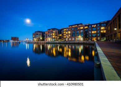The full moon over a waterfront apartment building in Fells Point, Baltimore, Maryland.