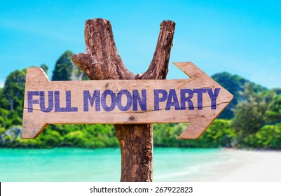 Full Moon Party wooden sign with beach background