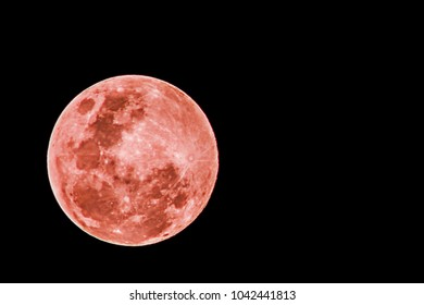 Full moon red on a black background.