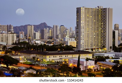 A full moon rises over Diamond Head and Downtown Honolulu on the island of Oahu, Hawaii.