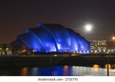 A full Moon rises over Glasgow's Armadillo building
