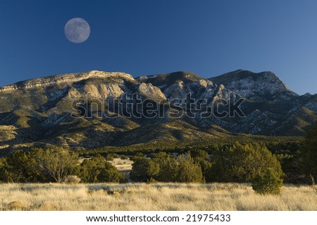 Full moon rises over the Sandia mountain range near Albuquerque, New Mexico