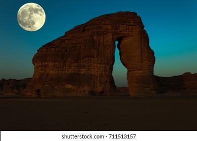 A full moon rising behind Elephant Rock; Al Ula; KSA
