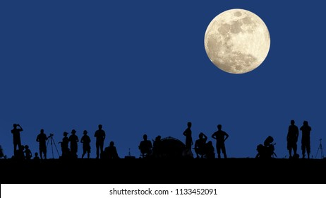 Full moon rising on the dark blue sky on nature. People on the edge lookout. Silhouettes. Panoramic photo