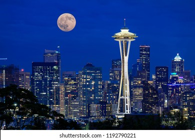 Full moon rising over the city of Seattle, WA