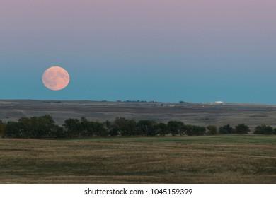 A full moon rising over the North Dakota prairie