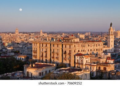 Full moon rising at sunset over Havana city, Cuba