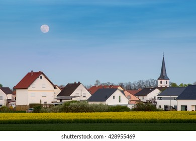 Full moon rising in Worms country side Germany