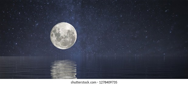 A Full Moon at Sea or over a lake with stars and reflection
