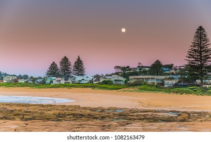 Full Moon at the Seaside - Capturing the sunrise and the 99.7 Waning Gibbous Moon from North Avoca Beach on the Central Coast, NSW, Australia.