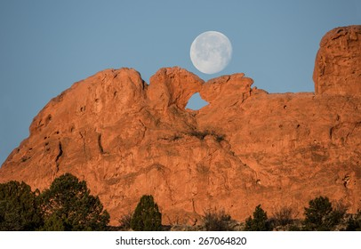 Full Moon Setting over Kissing Camels