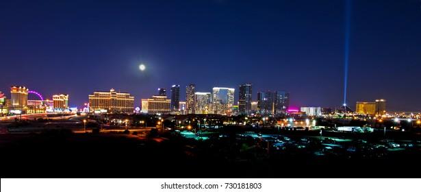 Full moon shining down on the Las Vegas Strip.