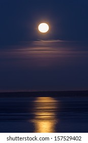 full moon in the sky in the early morning