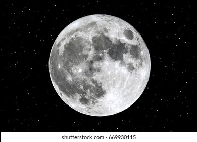 Full moon and stars are seen isolated on a black background. High contrast, high resolution image taken with a full frame dslr camera.