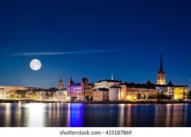 Full Moon (Super moon in 2015) rising over Stockholm old town. Multiple exposure shot for background and the Moon.