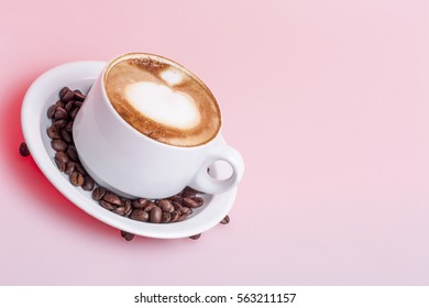 Full mug with milk coffee, white color cup and pink background, very tasty hot drink
