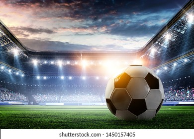 Full night football arena in lights with ball close up - Shutterstock ID 1450157405
