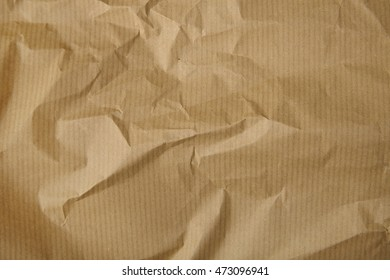 A full page of screwed up brown parcel wrapping paper texture