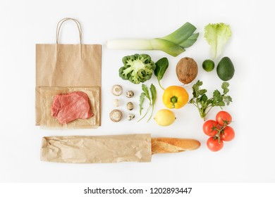 Full paper bag of different health food on white background. Top view. Flat lay. Healthy eating background, top view