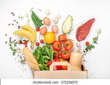 Full paper bag of different health food on a white background. Top view. Flat lay