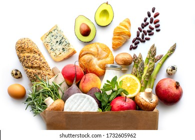 Full paper bag with healthy food.Vegetarian.Healthy food background.Supermarket food concept.Asparagus, cheese,fruits, vegetables, avocados and mushrooms.Shopping at the supermarket.Home delivery.Milk