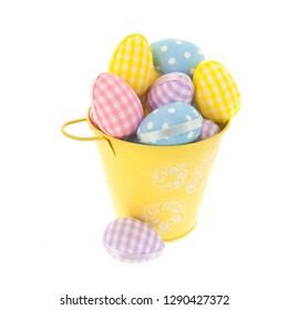 Full pastel colored easter eggs in bucket isolated over white background