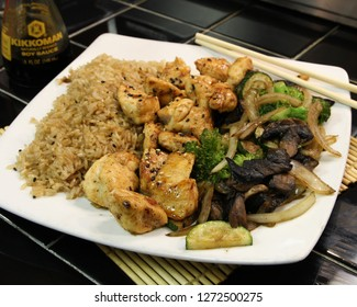 Full plate of fresh Chicken Hibachi with a side of rice and cooked vegetables.