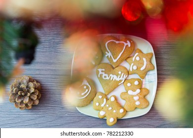 Full plate with handmade gingerbread under the Xmas tree