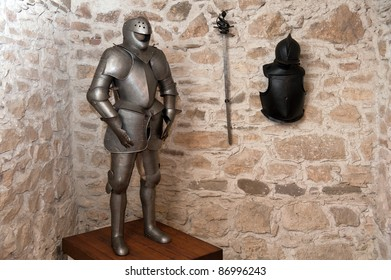 Full plate protective armor and sword of medieval warrior