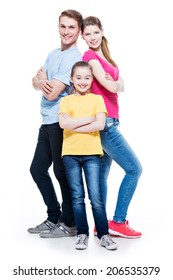Full portrait of happy attractive family with daughter standing back to back at studio - isolated on white.