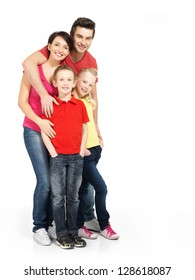 Full portrait of the happy young family with two children isolated on white background