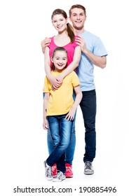 Full portrait of the happy young family with daughter in multicolor shirts - isolated on white background.