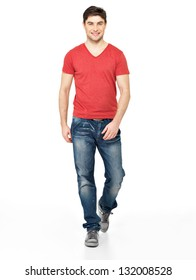 Full portrait of smiling  walking man in red t-shirt casuals  isolated on white background.