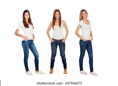Full portrait of three casual girls with jeans and white tshirts isolated