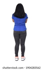 Full portrait of a woman from behind with arms crossed on white background