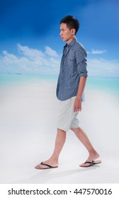Full portrait of young man walking at beach background
